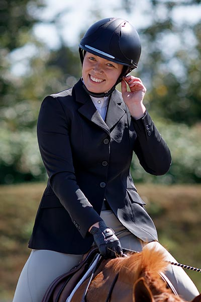 Assistant Trainer Danika Green Smiling on Horseback